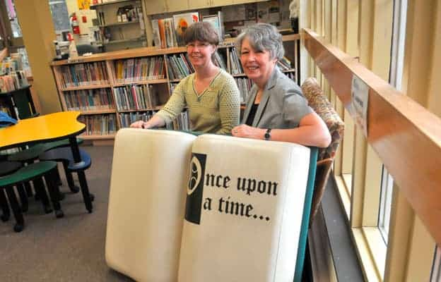 Elmira branch library staff members Carol Campbell (left) and Bette Cummings will be working different hours and handling various new programs suggested by the public.  [elena maystruk / the observer