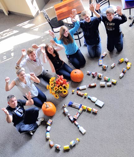 Kevin Fielding, Breanna Maier, Noah Steinmann, Sonya Martin, Danielle Johnson, Will Allen and Jedrek Martin are some of the CANS volunteers trick-or-treating for canned goods in Elmira this Halloween with donations going to the Region of Waterloo Food Bank. [Elena Maystruk  / The Observer]