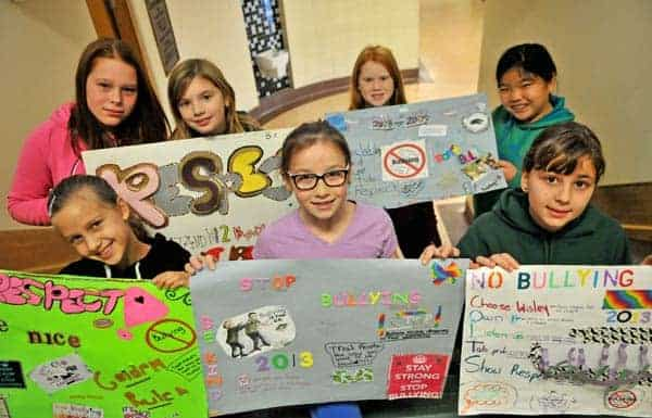 A region-wide school campaign, THINK, helped students speak, text, and generally treat fellow peers with respect this week. Conestogo PS students Brooke Richardson, Fiona Bevan, Brooke Schaefer and Heather McKaig show off their posters on Wednesday during their Grade 5-6 class' themed activities.  See story on page 5.[Elena Maystruk / The Observer]