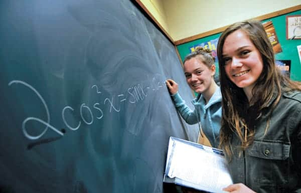 Studies suggest many of us can't solve the equation on the board, but we should be able to. Students such as Julia (right) and Alex Hildebrand, in EDSS teacher Christine Ruza's math classroom Wednesday, may eventually see changes as efforts are being made countrywide to improve math scores in all schools.  [Elena Maystruk / The Observer]