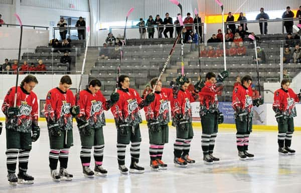 The Elmira Sugar Kings salute Austin Whittom during the team's Pink the Rink cancer fundraiser February 9 at the WMC.[Will Sloan / The Observer]