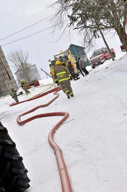 Five tankers were called to a Linwood-area barn fire on Monday, where water supply and the weather posed significant concerns. [Elena Maystruk / The Observer]
