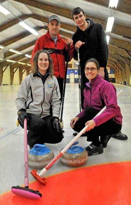 Colleeen Coghlin, Shawn Hamelin, David Miller, and Melody Martin keep their brooms on the ice at the Elmira Curling Club's headquarters.[Will Sloan / The Observer]