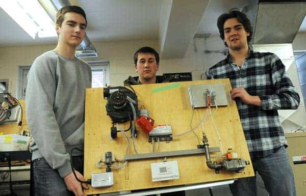 Cole Burkhart, Brady Erb, and Brodie Altman earned high marks at the Heating, Refrigeration and Air Conditioning Institute's HVAC competition in Toronto.[Will Sloan / The Observer]