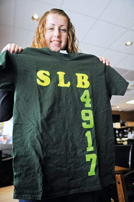 EDSS robotics club member Gwyneth Findlay shows off her team's number.[Will Sloan / The Observer]