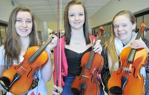 Emma Mewhiney and Camryn Cloostra  participate in the St. Jacobs PS strings program saved by Rachel Dyck's mother a decade ago. An April 3 concert will raise money to keep it going.[Elena Maystruk / The Observer]