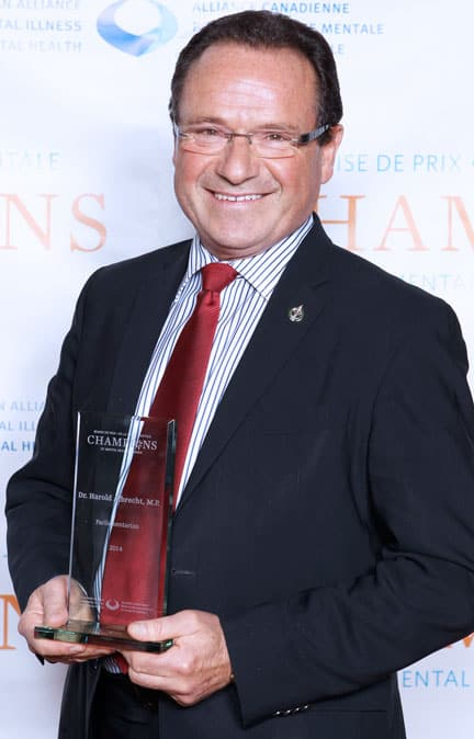 MP Harold Albrecht accepts an award for his work  on mental health issues.[Submitted]