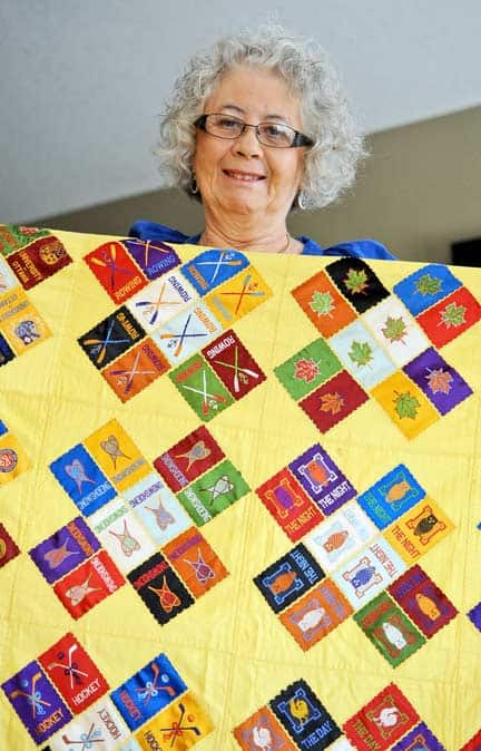 Jackie Gross' grandmother used discarded cigar silks to assemble her quilt over many years.[Will Sloan / The Observer]